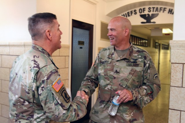 Brig. Gen. Tom Spencer, deputy commanding general (field artillery), Army National Guard (right) is welcomed to Fort Sill, Oct. 2, 2019, at McNair Hall.