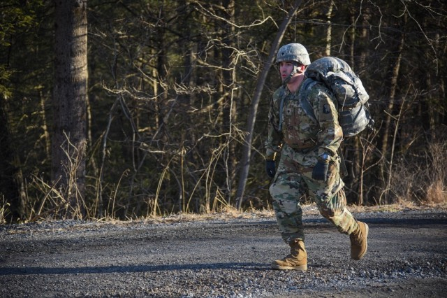 U.S. Army Spc. Sergo Dzamashvili participates in a 12-mile ruck march event as part of the 21st Signal Brigade Best Warrior Competition 2019 at Fort Indiantown Gap, Pa., on March 27, 2019.