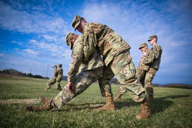 U.S. Army Spc. Sergo Dzamashvili (foreground, right) conducts Army Warrior Tasks (AWT) drills during the 21st Signal Brigade Best Warrior Competition 2019 at Fort Detrick, Md., March 25, 2019.