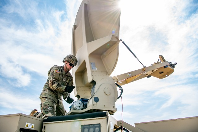 Pfc. Jacob Murray, a satellite communication systems operator assigned to the 75th Field Artillery Brigade, prepares a Satellite Transportable Terminal (STT) during a field training exercise. The STT is a focus system for CECOM supply availability.