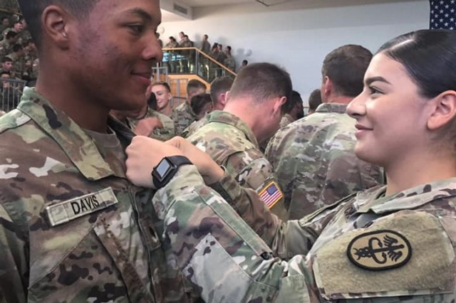 Pfc. Dontrale Davis from MEDDAC-Bavaria receives his Air Assault wings. Davis was among 27 Soldiers from across Regional Health Command Europe who earned their Army Air Assault wings on Sept. 20 at a graduation ceremony held in Grafenwoehr, Germany.