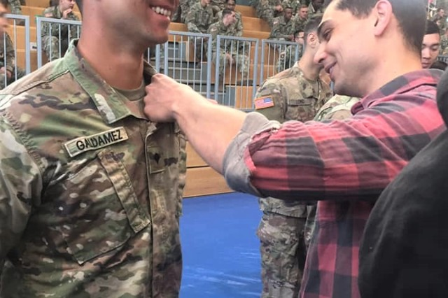 Pfc. Walter Galdamez from MEDDAC-Bavaria receives his Air Assault wings. Galdamez was among 27 Soldiers from across Regional Health Command Europe who earned their Army Air Assault wings on Sept. 20 at a graduation ceremony held in Grafenwoehr, Germany.