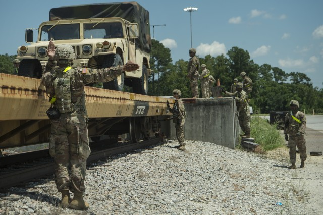 Soldiers from Fort Bragg, N.C., direct a Humvee onto a railcar during Exercise Dragon Lifeline at Joint Base Charleston's Naval Weapons Station, S.C., Aug. 7, 2019. The readiness exercise included service members from Fort Bragg; Joint Base Charleston, S.C.; and Joint Base Langley-Eustis, Va. It focused on the rapid deployment of equipment, vehicles and personnel. Participants shared knowledge and tested their efficiency in moving assets by air, land, rail and sea during the training event.