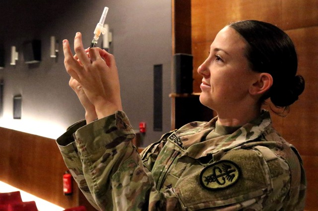 Cpl. Audi Edsell, a combat medic with Ansbach Health Clinic, prepares a needle for administration Oct. 9, 2018 at Illesheim Army Air Field, Germany. Medical readiness is an important necessity for deployed Soldiers as part of the Army's steadfast commitment to collective defense responsibilities in Europe.
