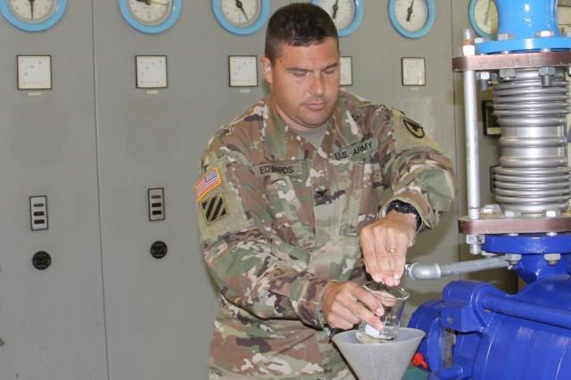 Col. Jason Edwards, U.S. Army Garrison Rheinland-Pfalz commander, takes a water sample at the Pfeffelbach Water Treatment Plant near Baumholder. The Pfeffelbach plant provides water to the Baumholder Military Community.