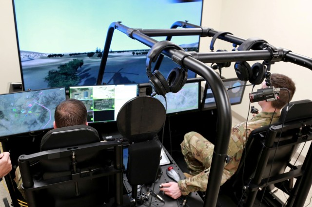 Soldiers use the Future Open Rotorcraft Cockpit Environment, or FORCE, simulator during a demo day in Huntsville, Alabama, in February. FORCE is a reconfigurable, extensible and portable platform that makes it possible to evaluate innovative technologies on a schedule of rapid integration. (Photo by Joseph Mendiola, U.S. Army Combat Capabilities Development Command (CCDC) -- Aviation & Missile Center)