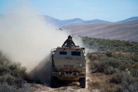 U.S. Army High Mobility Artillery Rocket Systems returns to the C-17 Globemaster III location after the HIMARS Rapid Infiltration demonstration during Exercise Mobility Guardian 2019, Selah Creek Landing Zone, Wash., Sept. 25, 2019. Exercise Mobility Guardian is Air Mobility Command's premier, large scale mobility exercise. Through robust and relevant training, Mobility Guardian improves the readiness and capabilities of Mobility Airmen to deliver rapid global mobility and builds a more lethal and ready Air Force.