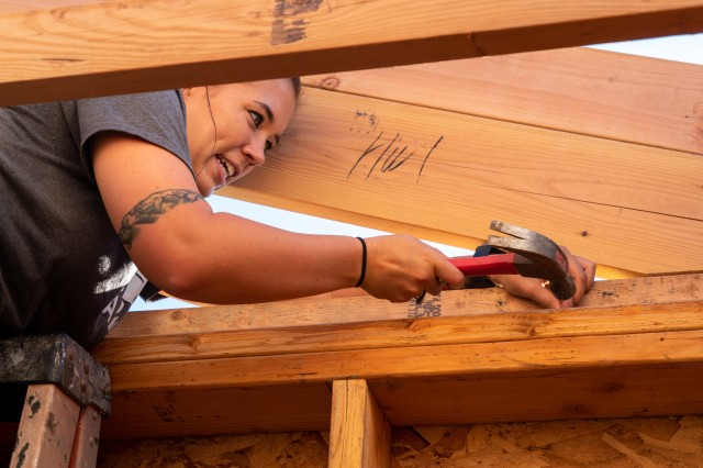 Seaman Mariah Hammond, a student at the Defense Language Institute, hammers nails while volunteering with with Habitat for Humanity Monterey Bay, Sept. 14.