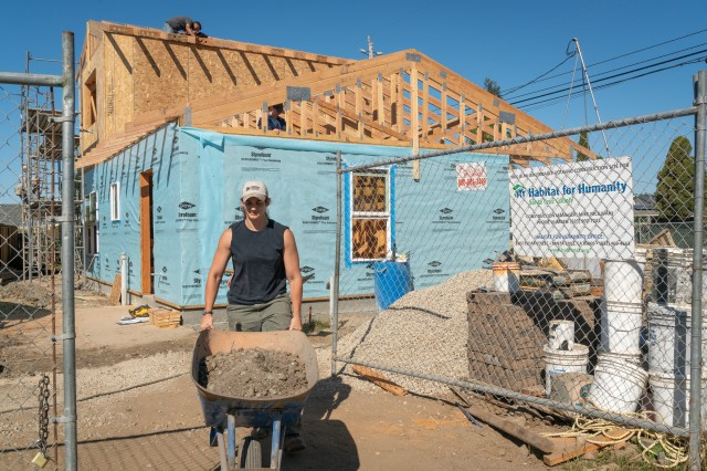 Seaman Elizabeth Carpenter, an Arabic language student at the Defense Language Institute, transports gravel while volunteering with with Habitat for Humanity Monterey Bay, Sept. 14.