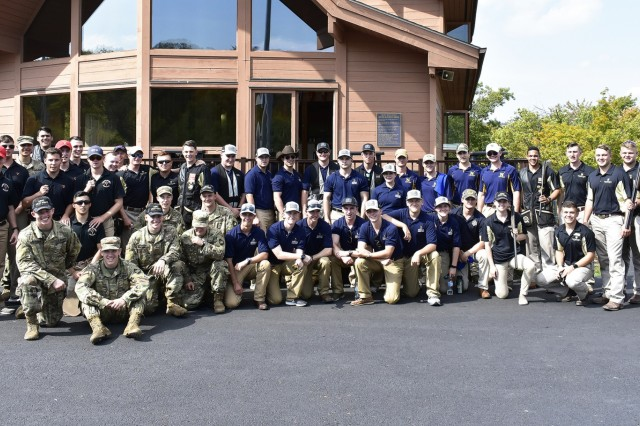 The U.S. Military Academy, U.S. Naval Academy, VMI and U.S. Merchant Marine Academy teams stand outside the Range 10 clubhouse for a picture concluding the first shoot in USMA Skeet and Trap history with all four teams present.