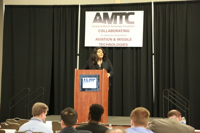 Christina Brantley, Aviation & Missile Technology Consortium program manager, addresses the crowd at an AMTC collaboration event in March of this year.