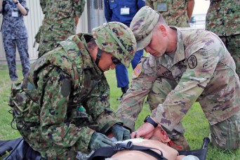 Japan, U.S. Medics tackle realistic combat casualty care