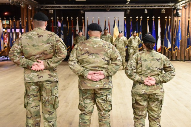 Capt. Sebastian D. Armentrout (left) prepares to accept command of the U.S. Army Garrison Rheinland-Pfalz Headquarters, Headquarters Company from Capt. Stephanie R. Correa (right) at a change of command ceremony Oct. 4 at Kazabra Club, Vogelweh. Garrison Commander Col. Jason T. Edwards (center) acted as ceremony reviewing officer.
