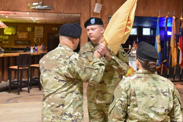 U.S. Army Garrison Rheinland-Pfalz Commander Col. Jason T. Edwards passes the guidon to Capt. Sebastian D. Armentrout at a change of command ceremony Oct. 4 at Kazabra Club, Vogelweh. Armentrout assumed command of the USAG RP Headquarters, Headquarters Company.