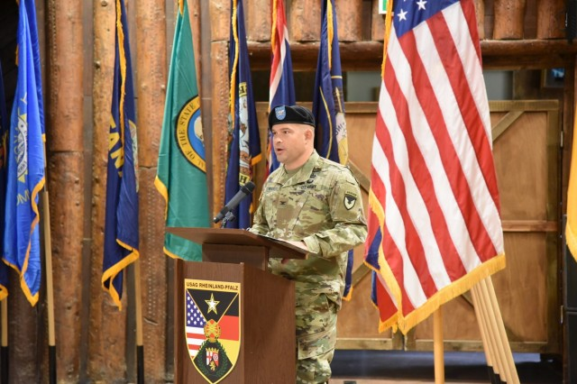 U.S. Army Garrison Rheinland-Pfalz Commander Col. Jason T. Edwards delivers remarks at a Headquarters, Headquarters Company change of command ceremony Oct. 4 at Kazabra Club, Vogelweh. Capt. Sebastian D. Armentrout is the new HHC commander.