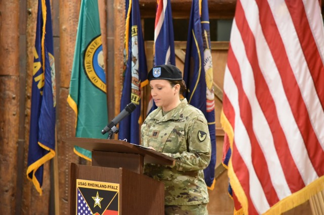Capt. Stephanie R. Correa delivers remarks at the U.S. Army Garrison Rheinland-Pfalz Headquarters, Headquarters Company change of command ceremony Oct. 4 at Kazabra Club, Vogelweh. Correa relinquished command to Capt. Sebastian D. Armentrout, new HHC commander.