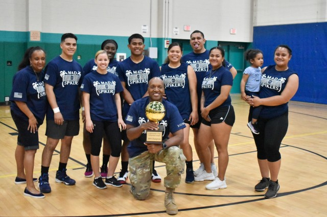 "Players for 3rd Battalion, 15th Infantry Regiment, 2nd Armored Brigade Combat Team, the ""Mad Spikers,"" pose for a photo with their trophy after the intramural volleyball championship game at Fort Stewart, Ga., Sept. 25. The ""Mad Spikers"" finished the season undefeated, beating 10th Brigade Engineer Battalion, 1st Armored Brigade Combat Team in the championship match 2 sets to 0. (U.S. Army Photo by Spc. Jordyn Worshek, Released)"
