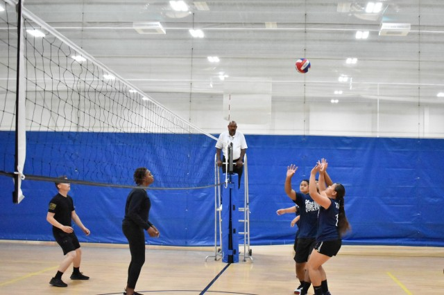 "Players from 3rd Battalion, 15th Infantry Regiment, 2nd Armored Brigade Combat Team, the ""Mad Spikers"" (right), get ready to return the ball during the intramural volleyball championship against 10th Brigade Engineer Battalion, 1st Armored Brigade Combat Team, at Fort Stewart, Ga., Sept. 25. The ""Mad Spikers"" were the epitome of team work as they won 2 sets in a row to defeat 10BEB in the championship match, finishing the season undefeated. (U.S. Army Photo by Spc. Jordyn Worshek, Released)"