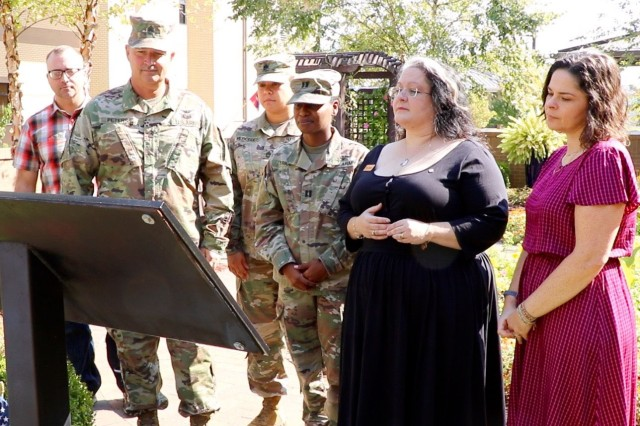 """From left, members of Sgt. Jeremy """"Jay"""" Seals Fort Campbell WTB leadership, Staff Sgt. Garrett Anderson, squad leader, Command Sgt. Maj. Steven Peters, first sergeant, Sgt. 1st Class Elizabeth Mercedes, platoon sergeant,  and Capt. Tabitha Trice, company commander joined Seals' widow Tori Seals and sister Holley Seals-Lizarraga to view a plaque in the WTB Memorial Garden. Sgt. Seals name was added to a plaque memorizing the battalion's fallen Soldiers during a rededication ceremony."""