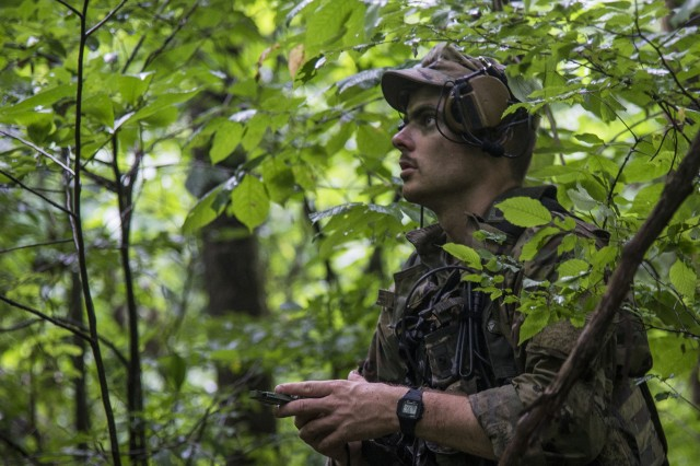Sgt. Kevin Deely, an infantryman with Company A, 1st Battalion, 148th Infantry Regiment, uses his compass to orient during a reconnaissance patrol on July 22, 2019, at Camp Atterbury, Ind. The 1-148th, part of the Ohio National Guard's 37th Infantry Brigade Combat Team, worked to maintain readiness in individual warrior proficiencies and squad- and platoon-level tactics during the battalion's two-week annual training.