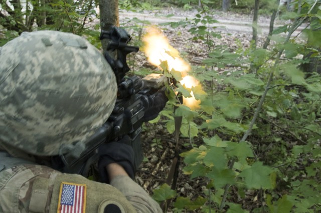 Pfc. Paul Robinette-Nakley, a Soldier with Company A, 1st Battalion, 148th Infantry Regiment, engages the enemy with his M249 Squad Automatic Weapon as part of an ambush during annual training July 23, 2019, at Camp Atterbury Joint Maneuver Center near Edinburgh, Ind. Soldiers of the 1-148th spent their annual training honing their skills in patrolling, reconnaissance and unit tactics.
