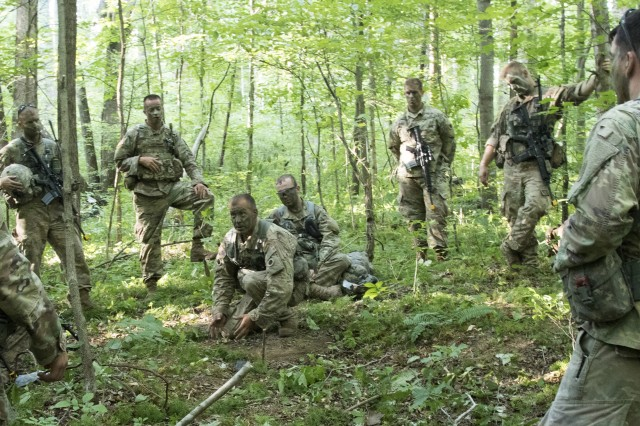 Soldiers of Company C, 1st Battalion, 148th Infantry Regiment plan an ambush for an enemy convoy during annual training July 23, 2019, at Camp Atterbury Joint Maneuver Center near Edinburgh, Ind. Soldiers of the 1-148th spent their annual training honing their skills in patrolling, reconnaissance and unit tactics.