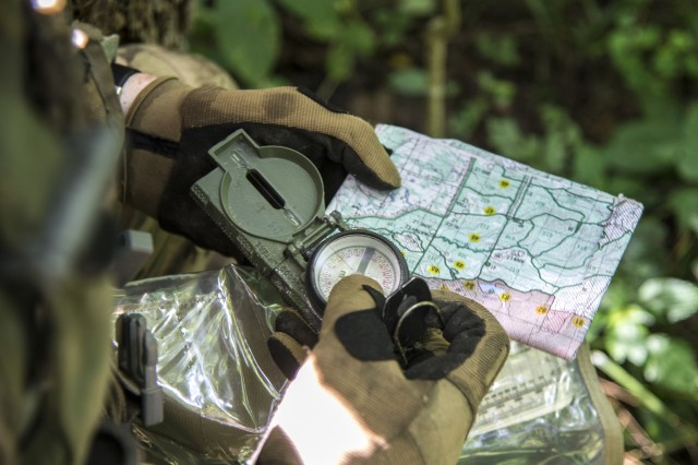 An infantryman with Company A, 1st Battalion, 148th Infantry Regiment refers to his map during a training patrol on July 22, 2019, at Camp Atterbury, Ind. The 1-148th, part of the Ohio National Guard's 37th Infantry Brigade Combat Team, worked to maintain readiness in individual warrior proficiencies and squad- and platoon-level tactics during the battalion's two-week annual training.