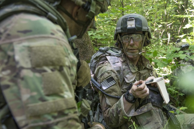 2nd Lt. Zach Winters, 2nd Platoon leader Company A, 1st Battalion, 148th Infantry Regiment, directs one of his squad leaders during a training patrol July 22, 2019, at Camp Atterbury, Ind. The 1-148th, part of the Ohio National Guard's 37th Infantry Brigade Combat Team, worked to maintain readiness in individual warrior proficiencies and squad- and platoon-level tactics during the battalion's two-week annual training.