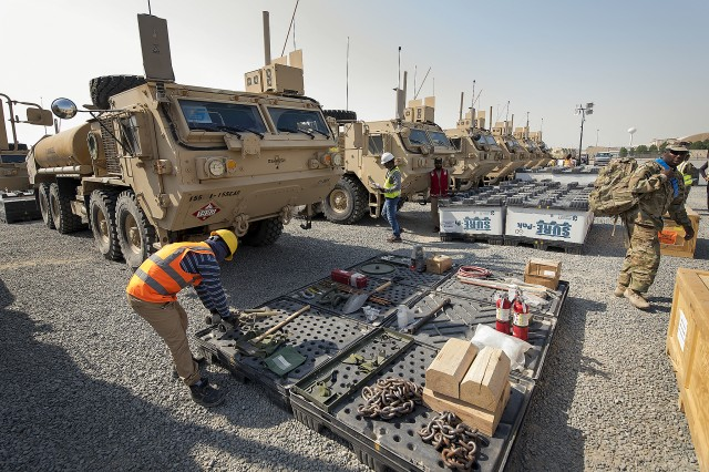 Contractors at Army Prepositioned Stocks-5 begin to lay out all the basic issue items associated with each vehicle being issued to the Juggernaut Forward Support Company, 1st Battalion, 8th Infantry Regiment, 3rd Armored Brigade Combat Team, 4th Infantry Division at Camp Arifjan, Kuwait, Sept. 27.