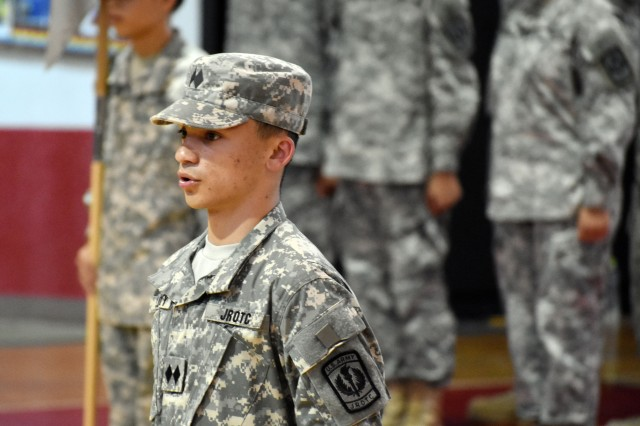 Cadet Lt. Col. Maxwell Orlosky, commander of the Junior Reserve Officers' Training Corps' Trojan Battalion at Zama Middle High School, speaks during a promotion ceremony at Camp Zama, Japan, Oct. 3.