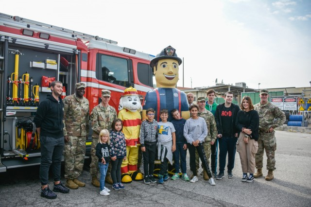 Kids from Vicenza for Children smile with USAG Italy leadership on Caserma Ederle, Vicenza, Italy Friday, Oct. 4. National Fire Prevention Week Oct. 6-12, 2019.