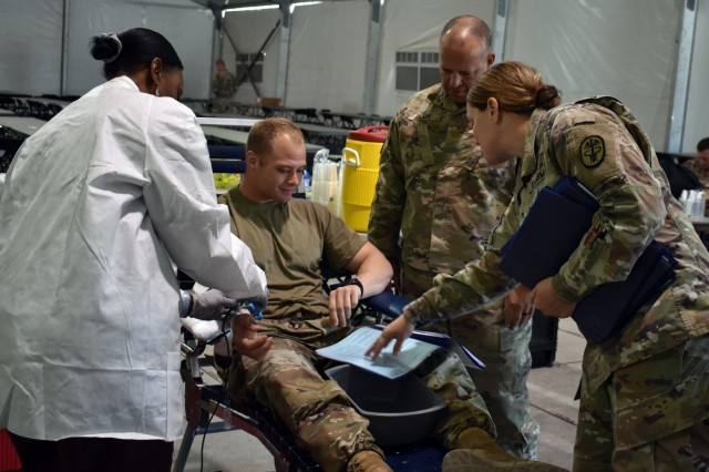 U.S. medical Soldiers in the 230th Brigade Support Battalion, 30th Armored Brigade Combat Team, North Carolina National Guard, host a blood drive to establish an O-negative blood-type donor pool in the vicinity of Fort Bliss, Texas, Sept. 27, 2019. The drive will support units deploying to support Operation Spartan Shield in the Middle East.