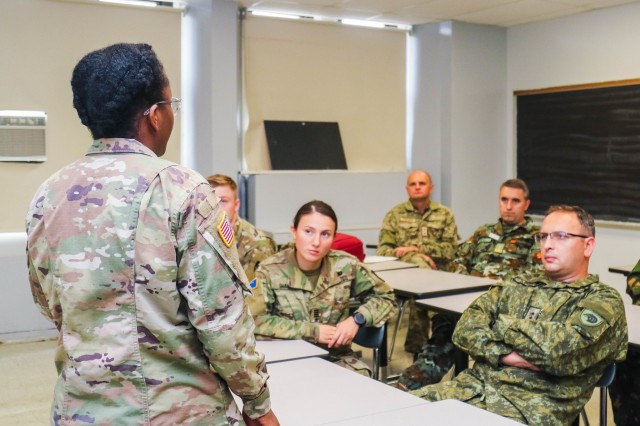 Class of 2020 Cadet Adaya Queen talks to visiting officers in the Army War College international fellows program during their visit to the U.S. Military Academy Oct, 2, 2019. (U.S. Army photo by Brandon O'Connor)