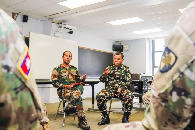 Visiting officers in the Army War College international fellows program talk with U.S. Military Academy cadets during a visit to the academy Oct. 2, 2019. (U.S. Army photo by Brandon O'Connor)
