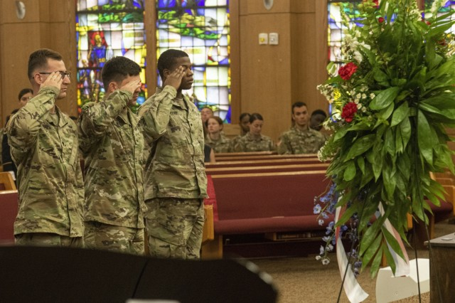 Soldiers from the 57th Sapper Company, 27th Engineer Battalion (Airborne), pay their respects to fallen paratrooper Spc. Akeem A. Cameron, a combat engineer assigned to the 57th SC, 27th EN BN (A), during his memorial ceremony on October 1, 2019, at All American Chapel, Fort Bragg, N.C. Soldiers rendered a salute to their fallen teammate after making their way to his memorial display. (U.S. Army photo by Pfc. Daniel J. Alkana, 22nd Mobile Public Affairs Detachment)