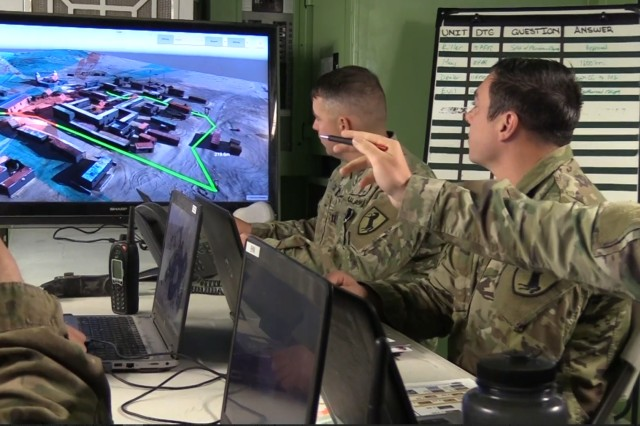U.S. Army Soldiers use ATLAS, or Artificially Intelligent Targeting System, for mission brief. Thought leaders will discuss how technology could bridge the gap between virtual modeling and simulation and real world 3D terrain in Geographic Information Systems during a Association of the United States Army Contemporary Military Forum.
