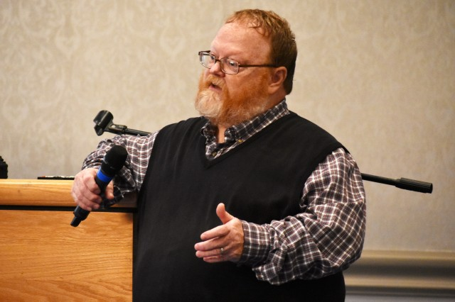 Stan Austin, manager of the Army Community Service Family Advocacy Program at Camp Zama, speaks during the program's senior leader domestic violence symposium at the Camp Zama Community Club, Camp Zama, Japan, Oct. 4.