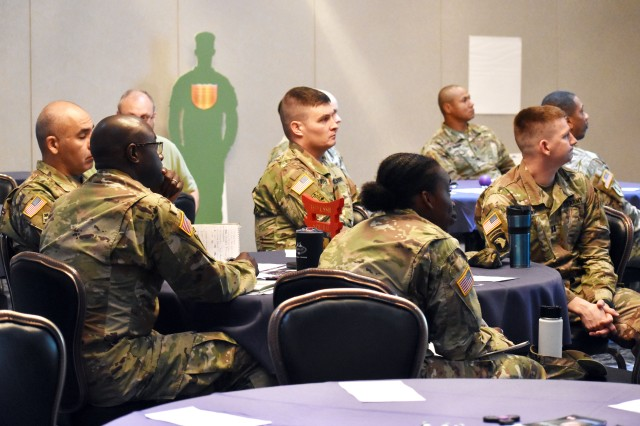 Senior leaders listen during the Family Advocacy Program's domestic violence symposium at the Camp Zama Community Club, Camp Zama, Japan, Oct. 4.