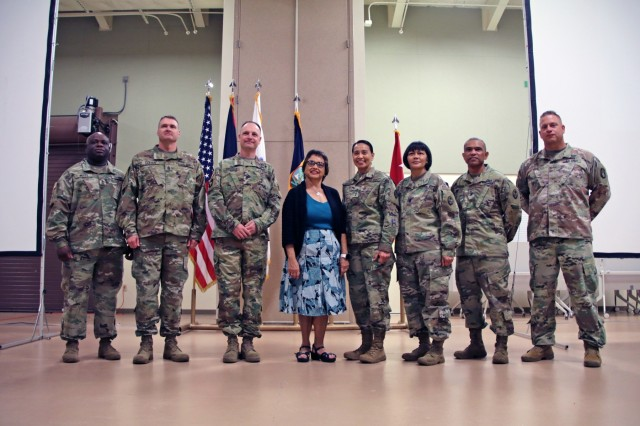 "From left to right, Command Sgt. Maj. Dennis M. Petty, Task Force Talon senior enlisted advisor; Command Sgt. Maj. Neil Sartain, 38th Air Defense Artillery Brigade senior enlisted advisor; Col. Patrick M. Costello, 38th ADA Brigade commander; Guam Gov. Lourdes A. Leon Guerrero, Guam Army National Guard commander-in-chief; Maj. Gen. Esther J. Aguigui, GU ARNG adjutant general; Command Sgt. Maj. Agnes Q. Diaz; GU ARNG senior enlisted advisor; Col. Kory Gacono; GU ARNG assistant adjutant general; and Maj. Bryan Lipe, TF Talon officer in charge, gather during 1224th Engineer Support ""Hita"" Company's mobilization ceremony, Oct. 6. Hita Company assumed active duty status in preparation for assuming the 12-month security force mission of Site Armadillo from Task Force Guahan, the first GU ARNG SECFOR rotation currently in place."