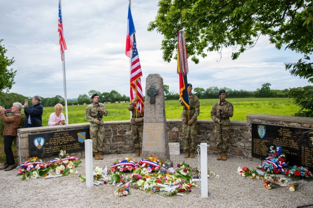 Soldiers of the 101st Airborne Division (Air Assault) color guard post the colors in front at the Magneville Memorial during a ceremony in Magneville, France June 4, 2019. The memorial was built in honor of the 18 paratroopers of the 506th Parachute Infantry Regiment of the 101st Airborne Division and four C-47 transport crew members who were shot down on June 6, 1944. The memorial was established by residents of Magneville in 1948 to honor Allied servicemen who died in two separate crashes in the vicinity of Magneville in June 1944.