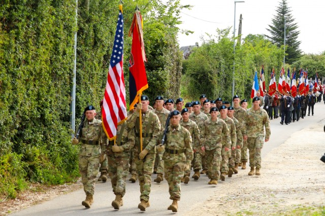 Soldiers of the 101st Airborne Division (Air Assault) march down the streets of Magneville, France June 4, 2019. The memorial was built in honor of the 18 paratroopers of the 506th Parachute Infantry Regiment of the 101st Airborne Division and four C-47 transport crew members who were shot down on June 6, 1944.  A memorial was established by residents of Magneville in 1948 to honor Allied servicemen who died in two separate crashes in the vicinity of Magneville in June 1944.