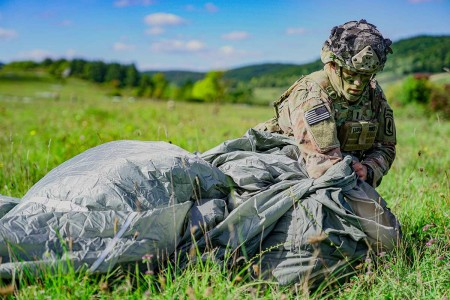 A paratrooper from the 173rd Airborne Brigade, packs his parachute following an airborne jump during exercise Saber Junction 2019, at the Hohenfels Training Area, Sept. 18, 2019. SJ19 is an exercise involving nearly 5,400 participants from 16 ally and partner nations at the U.S. Army's Grafenwoehr and Hohenfels Training Areas, Sept. 3 to 30 Sept. 2019.