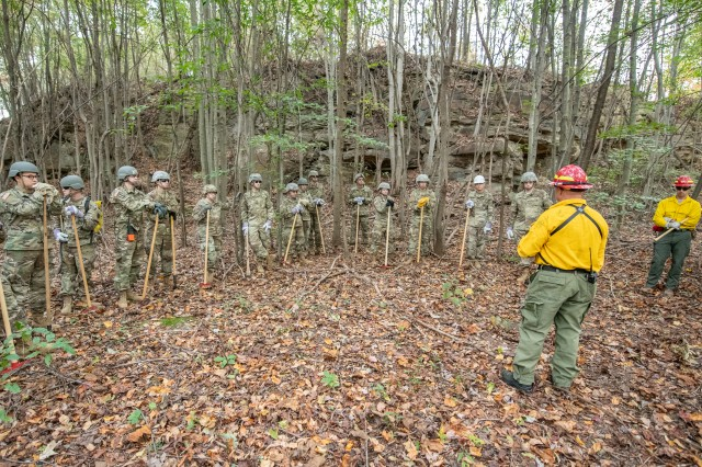 Members of the West Virginia Army National Guard's 249th Army Band participate in basic wildland fire suppression training, conducted by the West Virginia Division of Forestry in Morgantown, West Virginia, Oct. 3, 2019. The training covered basic wildland fire fighting techniques including understanding fire behavior, suppression tactics and techniques, crew organization, communications, and crew safety and awareness, with the goal of providing WNVG Soldiers the basic skills and experience to operate on a fire line side-by-side with experienced Division of Forestry personnel.