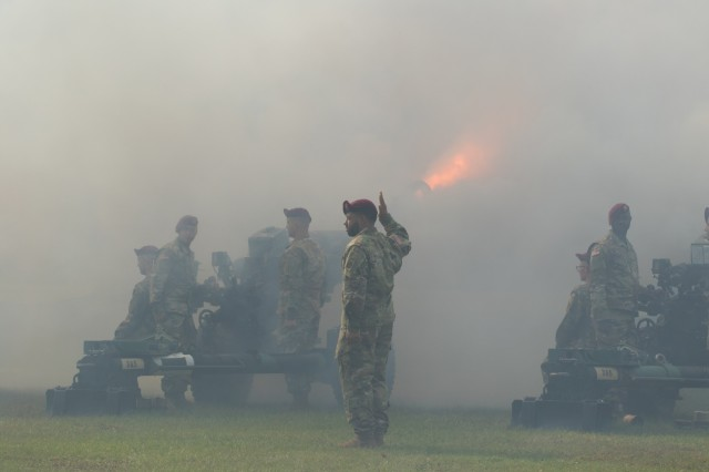 "Artillerymen with the 3rd Battalion, 319th Field Artillery Regiment, fire artillery pieces at the XVIII Airborne Corps Change of Command Ceremony at the main post flagpole on Fort Bragg, N.C. on Oct. 7, 2019. Lt. Gen. Michael ""Erik"" Kurilla took command of the XVIII Airborne Corps from Lt. Gen. Paul J. LaCamera during the ceremony. (U.S. Army Photo by Spc. Adam M. Manternach, 22nd Mobile Public Affairs Detachment)"