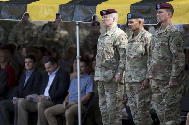 "From left, Lt. Gen. Paul J. LaCamera, the outgoing XVIII Airborne Corps commanding general, Gen. Michael X. Garrett, U.S. Army Forces Command commander, and Lt. Gen. Michael ""Erik"" Kurilla, the incoming XVIII Airborne Corps commander, stand at attention before rendering honors to the colors at the XVIII Airborne Corps change of command ceremony at the main post flagpole at Fort Bragg, N.C., Oct. 7, 2019. LaCamera relinquished command of the XVIII Abn. Corps after 21 months in command. (U.S. Army Photo by Sgt. Andrew McNeil, 22nd Mobile Public Affairs Detachment)"