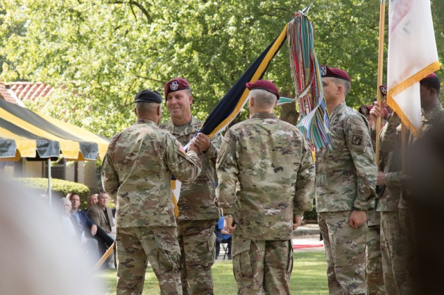 "Lt. Gen. Michael ""Erik"" Kurilla takes the XVIII Airborne Corps colors from Gen. Michael X. Garrett, United States Forces Command commander, signifying his taking command of the corps during the XVIII Airborne Corps Change of Command Ceremony at the main post flagpole on Fort Bragg, N.C., Oct. 7, 2019.  Kurilla, an Elk River, M.N. native, most recently served as chief of staff of Central Command and is no stranger to Fort Bragg, having served as the commander of the 82nd Airborne Division. (U.S. Army Photo by Spc. Adam M. Manternach, 22nd Mobile Public Affairs Detachment)"