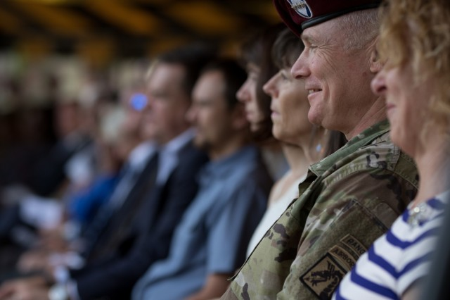 "Lt. Gen. Paul J. LaCamera, the outgoing XVIII Airborne Corps commanding general, smiles at remarks made during the XVIII Airborne Corps Change of Command Ceremony at the main post flagpole on Fort Bragg, N.C. on Oct. 7, 2019. LaCamera relinquished command of the XVIII Airborne Corps to Lt. Gen. Michael ""Erik"" Kurilla. (U.S. Army Photo by Sgt. Andrew McNeil, 22nd Mobile Public Affairs Detachment)"