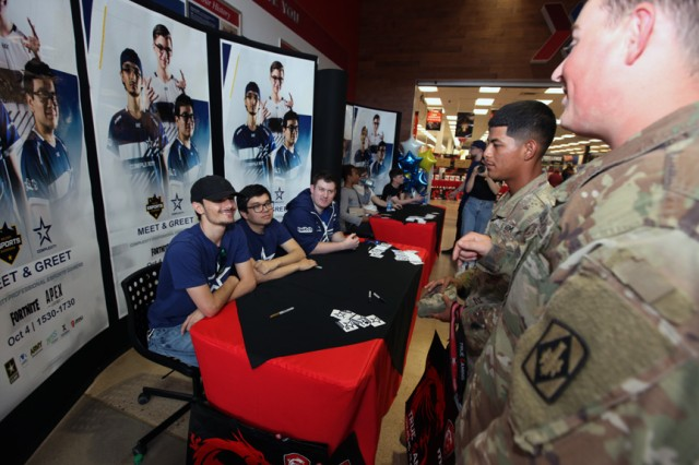 compLexity professional gamers Gabeismon, Reptar, and Meerko meet with Soldiers Oct. 4, 2019, at the Fort Sill Main Exchange. The players were here to learn about how Soldiers are trained, and for the Lawton-Fort Sill community to learn gaming tips from the pros.