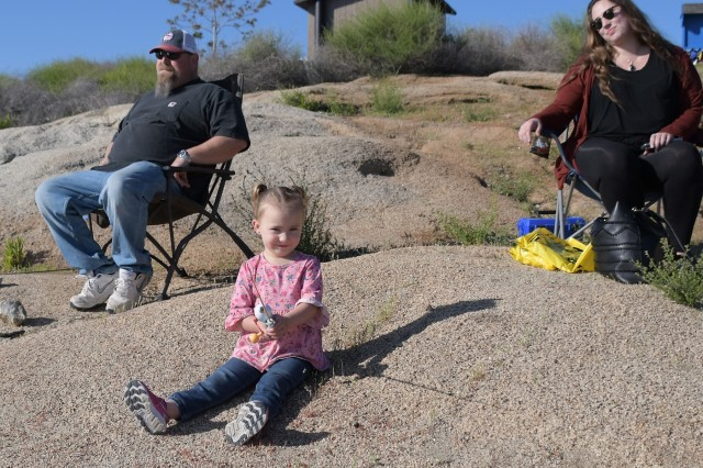 Three year old Prudance waits to see if she gets a tug on the line during Kid's Fishing Day at the Corps of Engineer's Hensley Lake outside of Madera, California, on April 13.
