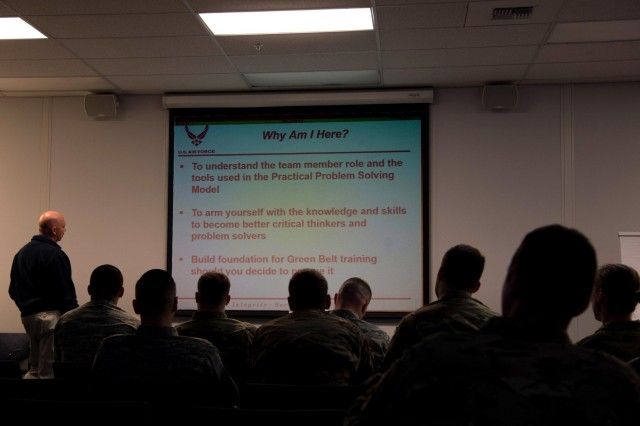 Bryan Dochnahl, left, 62nd Airlift Wing Manpower Office's wing process manager, teaches the Practical Problem Solving Model class to 627th Logistics Readiness Squadron Airmen at Joint Base Lewis-McChord Sept. 20.